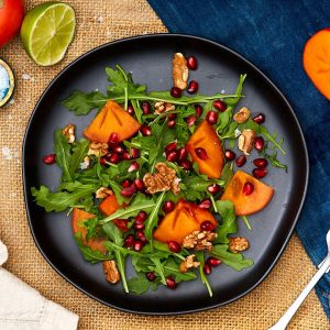Arugula, Persimmon Salad with Toasted Walnuts and Pomegranate Vinaigrette